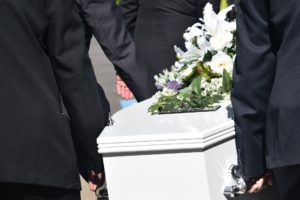 Grief as casket carried at funeral