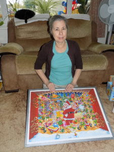 My mum with completed puzzle