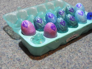 Open 12 pack of Hatchimals, close up