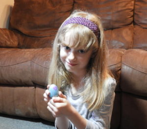 Girl holding toy egg