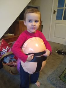 toddler wearing inflatable belly
