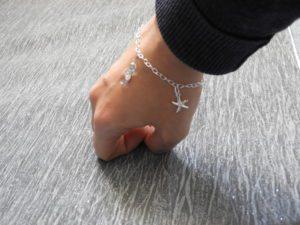 Bracelet being worn on lady's wrist
