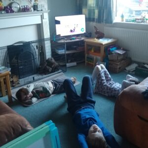 family completing Joe Wicks workout